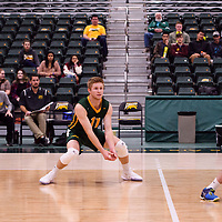 4th year setter Michael Corrigan (11) of the Regina Cougars in action during the Women's Volleyball Home Game vs U of C Dinos on October21 at the CKHS University of Regina. Credit Arthur Ward/©Arthur Images 2017