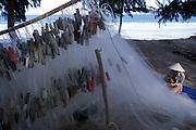 Repairing fishing nets, near Nha Trang, Vietnam