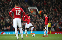Manchester United's Romelu Lukaku (centre) and Jesse Lingard (right) stand dejected after conceding the first goal of the game