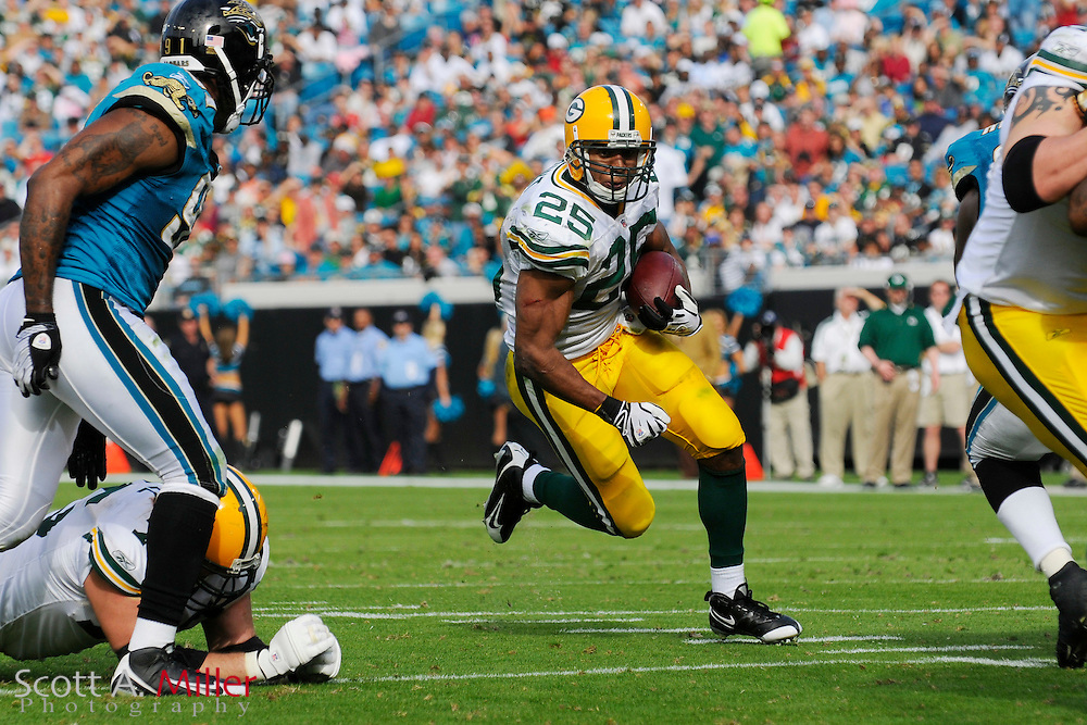 Dec. 14, 2008; Orlando, FL, USA; Green Bay Packers running back Ryan Grant (25) heads up field during the first half of the Packers game against the Jacksonville Jaguars at Jacksonville Municipal Stadium. Mandatory Credit: Scott A. Miller-US PRESSWIRE...©2008 Scott A. Miller