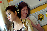 BTS skytrain. Passenger with ad poster.