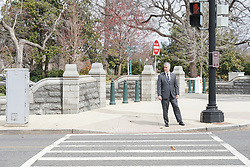 A man waiting to cross the road in Washington DC in the United States. From a series of travel photos in the United States. Photo date: Friday, March 30, 2018. Photo credit should read: Richard Gray/EMPICS