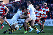 Gloucester centre Mark Atkinson tackled during the Aviva Premiership match between Gloucester Rugby and Wasps at the Kingsholm Stadium, Gloucester, United Kingdom on 24 February 2018. Picture by Alan Franklin.