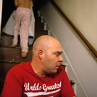Mike Allen sits on the steps as his daughter heads to bed.