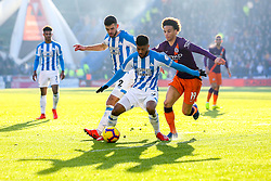 Leroy Sane of Manchester City takes on Elias Kachunga and Tommy Smith of Huddersfield Town - Mandatory by-line: Robbie Stephenson/JMP - 20/01/2019 - FOOTBALL - The John Smith's Stadium - Huddersfield, England - Huddersfield Town v Manchester City - Premier League