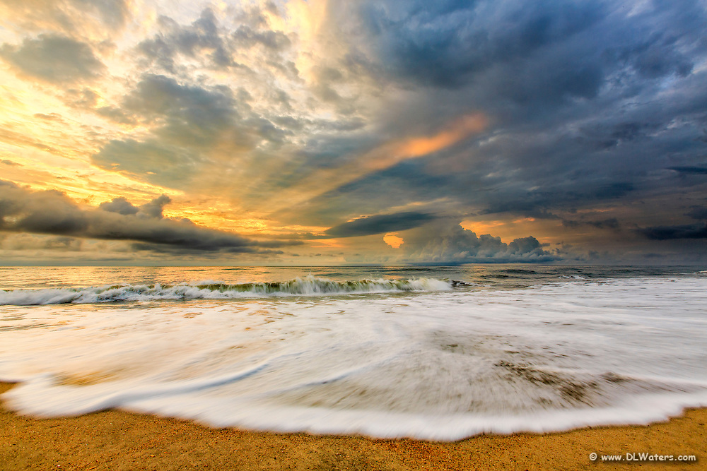 Sunrise and clouds over Outer Banks beach.