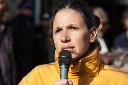 London, UK. 9th February, 2019. Bettina Maidment of Plastic Free Hackney addresses activists from Extinction Rebellion blocking Kingsland Road in Dalston as part of a 'Saturday street party' intended as a means of engagement around climate change and environmental issues with the local community.