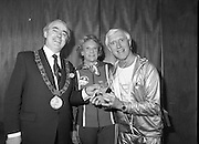 Jimmy Saville at the C.R.C.       (N71)..1981..26.04.1981..04,26.1981..26th April 1981..At the completion of the Fourteenth Annual Walk in aid of the Central Remedial Clinic in Clontarf, Jimmy Saville visited the CRC itself. Mr Saville was awarded an inscribed silver medallion, designed by Kilkenny Design Workshop, in recognition of his work in fundraising for the clinic..Photograph shows Alderman Fergus O'Brien,Lord Mayor of Dublin presenting Jimmy Saville with the specially inscribed medallion for his services to the C.R.C. Lady Goulding is also included in the picture.