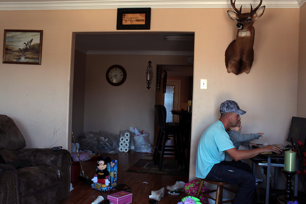 Jason Melerine with his son Jason Malerine Jr., 2, at their home in Violet, LA on November 8, 2010.