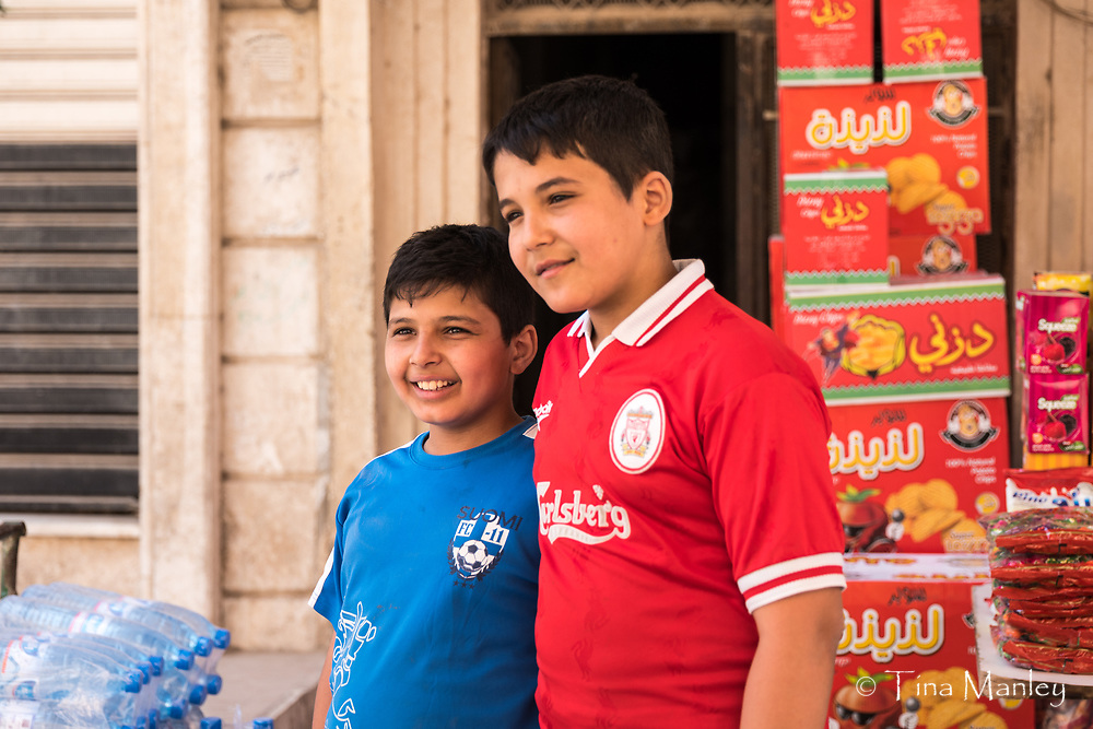 Syrian boys with soccer shirts in front of snack shop in Hasakah, Syria.