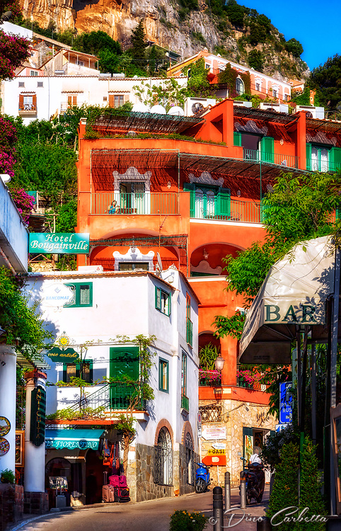 """""""Positano Hotel La Bougainville walking along Via Cristoforo Colombo""""...<br /> <br /> As evening descended upon the second exhilarating day in Positano, the villas and flowers posed graciously one last time for this weary photographer. All indications seemed to verify that late May in Positano presented a spectacular pallet of every color under God's rainbow. This quaint seaside village stimulated one's senses, aggrandizing its chest and boasting specular perfection. I cannot imagine a more benevolent time of year than during late spring to visit the bellissimo Amalfi coast. This image was my last of the evening before a long hike up to the terrace of Hotel Montemare's famous restaurant. Finally, time to relax and unwind while admiring yet another truly breathtaking sea view of Positano Bay."""