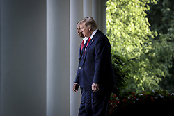 President Donald Trump accompanied by Tiger Woods walk out of the Oval Office for a ceremony in the Rose Garden of the White House on May 6, 2019. Trump will present Tiger Woods the Presidential Medal of Freedom in Washington, DC. (Photo by Oliver Contreras/SIPA USA)