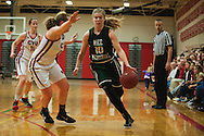 Rice's Stephanie Langlais (10) dribbles the ball past CVU's Marlee Gunn (13) during the girls basketball game between the Rice Green Knights and the Champlain Valley Union Redhawks at CVU High School on Monday night December 14, 2015 in Hinesburg. (BRIAN JENKINS/for the FREE PRESS)