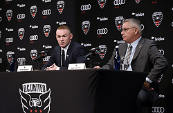 English international soccer player Wayne Rooney speaks as Dave Kasper , United General Manager and VP of Soccer Operations looks on during the media unveiling at the Newseum on July 2, 2018 in Washington, DC. Photo by Olivier Douliery/ Abaca Press