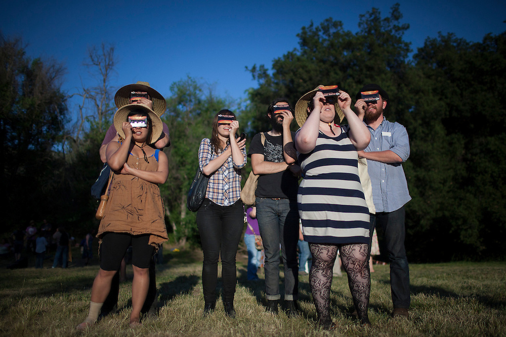 Spectators observe the Solar Eclipse through eye protection during this year's 52nd annual Topanga Canyon Banjo and Fiddle Festival on May 20, 2012. ..(Photo by Benjamin B. Morris ©2012)