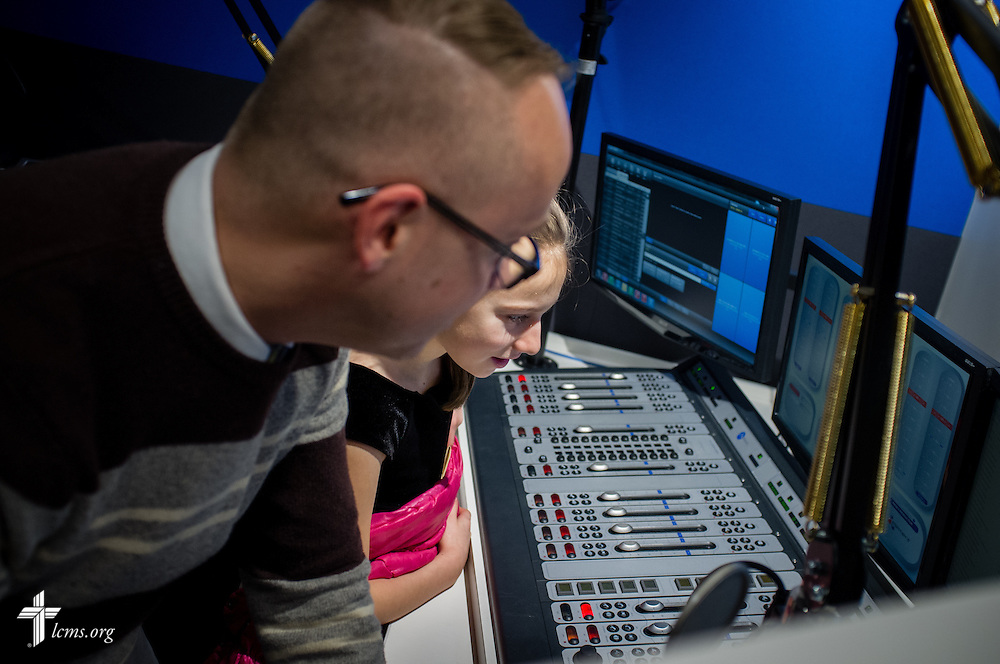 KFUO's Andy Bates shows Rachel Stinnett the control deck after she recorded several items for later broadcast during missionary orientation activities at The Lutheran Church–Missouri Synod International Center on Wednesday, March 4, 2015,  in Kirkwood, Mo. LCMS Communications/Erik M. Lunsford