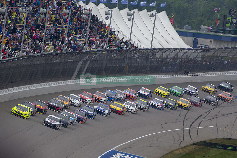 June 10, 2018 - Brooklyn, Michigan, United States of America - Kevin Harvick (4) and Paul Menard (21) lead the field for the FireKeepers Casino 400 at Michigan International Speedway in Brooklyn, Michigan. (Credit Image: © Stephen A. Arce/ASP via ZUMA Wire)