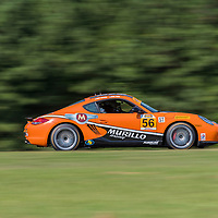 Alton, VA - Aug 26, 2016:  The Murillo Racing Porsche Cayman races through the turns at the Oak Tree Grand Prix at Virginia International Raceway in Alton, VA.