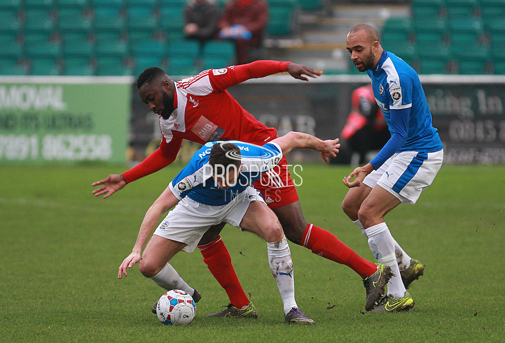 Dover midfielder Jack Parkinson shields the ball from Whitehawk's David Ijaha during the FA Trophy match between Whitehawk FC and Dover Athletic at the Enclosed Ground, Whitehawk, United Kingdom on 12 December 2015. Photo by Bennett Dean.