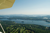 Overlooking Laconia Country Club out to Paugus Bay and Lake Winnipesaukee from Lakes Biplane.