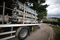 © Licensed to London News Pictures. 05/08/2019. Whaley Bridge, UK. High-capacity water pipes are delivered to the reservoir . The town of Whaley Bridge in Derbyshire remains evacuated after heavy rain caused damage to the Toddbrook Reservoir , threatening homes and businesses with flooding . Photo credit: Joel Goodman/LNP