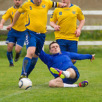 Clare's David McCarthy goes in with a slide tackle against Roscommon's Peter Keighery
