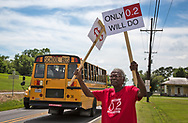 Robert Taylor and other members of the Concerned Citizens Of St John group protest near a school in Reserve LA, where they hope to bring awareness of the danger of  high levels of chloroprene emissions being emitted by Denka/Dupont in St. John the Baptist Parish. The levels emitted in the area are much higher than  the recommended EPA  standard for chloroprene, a likely human carcinogen. May 17, 2017