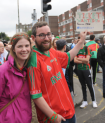 Lynsey Muir and Fergal Foley from Castlebar on the hunt a spare ticket. <br />