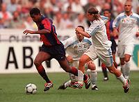 Patrick Kluivert (Barcelona) and Roberto Baronio (Lazio). Barcelona v Lazio. The Amsterdam Tournament. Amsterdam Arena, 5/8/2000. Credit: Colorsport / Stuart MacFarlane.