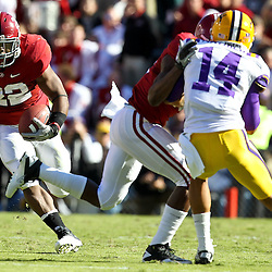 November 6, 2010; Baton Rouge, LA, USA; Alabama Crimson Tide running back Mark Ingram (22) runs against the LSU Tigers during the first half at Tiger Stadium. LSU defeated Alabama 24-21.  Mandatory Credit: Derick E. Hingle