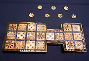 The Royal Game of Ur, also known as the Game of Twenty Squares found in the Royal Tombs of Ur in Iraq by Sir Leonard Woolley in the 1920s. dates from the First Dynasty of Ur, before 2600 BC, thus making the Royal Game of Ur probably the oldest set of board gaming equipment ever found. The game is still played in Iraq to this day.