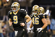 NEW ORLEANS, LA - DECEMBER 26:   Quarterback Drew Brees #9 of the New Orleans Saints jogs onto the field before a game against the Atlanta Falcons at Mercedes-Benz Superdome on December 26, 2011 in New Orleans, Louisiana.  The Saints defeated the Falcons 45-16.  (Photo by Wesley Hitt/Getty Images) *** Local Caption *** Drew Brees