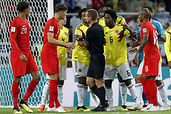 (l-r) John Stones of England, Santiago Arias of Colombia, Yerry Mina of Colombia, referee Mark Geiger, Carlos Sanchez of Colombia, Ashley Young of England during the 2018 FIFA World Cup Russia round of 16 match between Columbia and England at the Spartak stadium  on July 03, 2018 in Moscow, Russia