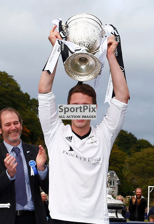 2015 SSE Scottish Hydro Camanachd Cup Final Saturday 19th September at Mossfield Stadium, Oban....Daniel Grieve, Lovat captain holds aloft the Camanach Cup after beating Kyles Athletic 2-1....(c) STEPHEN LAWSON | SportPix.org.uk