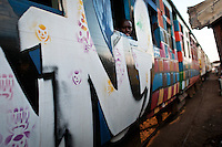 "The ""Peace Train"", covered in graffiti from local artists urging a peaceful elections, pulls through Kibera as residents wait anxiously for the final election results to be tallied."