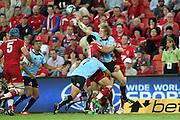 Ryan Cross passes past by Digby Ioane. Queensland Reds v NSW Waratahs. Investec Super Rugby Round 10 Match, 24 April 2011. Suncorp Stadium, Brisbane, Australia. Reds won 19-15. Photo: Clay Cross / photosport.co.nz