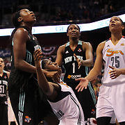 Chiney Ogwumike, (below), Connecticut Sun, the WNBA number one draft pick making her WNBA debut, after being hit hard by Tina Charles, New York Liberty, the former Sun player, during the Connecticut Sun Vs New York Liberty WNBA regular season game at Mohegan Sun Arena, Uncasville, Connecticut, USA. 16th May 2014. Photo Tim Clayton