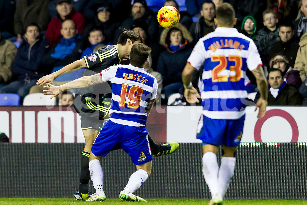 Jamie Mackie of Reading puts pressure in George Friend of Middlesbrough during the Sky Bet Championship match between Reading and Middlesbrough at the Madejski Stadium, Reading, England on 10 January 2015. Photo by Gareth  Brown.