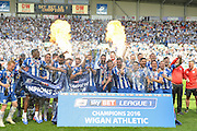 Wigan lift the League 1 trophy after Sky Bet League 1 match between Wigan Athletic and Barnsley at the DW Stadium, Wigan, England on 8 May 2016. Photo by John Marfleet.