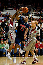 February 27, 2010; Stanford, CA, USA;  Stanford Cardinal guard Jeremy Green (45) blocks a shot from Arizona Wildcats forward Derrick Williams (23) during the first half at Maples Pavilion.  Arizona defeated Stanford 71-69.