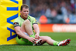 Northampton Hooker Dylan Hartley (capt) takes a moment and ties his laces behind the post pad - Photo mandatory by-line: Rogan Thomson/JMP - 07966 386802 - 11/04/2015 - SPORT - RUGBY UNION - Exeter, England - Sandy Park Stadium - Exeter Chiefs v Northampton Saints - Aviva Premiership.