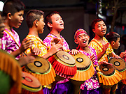 19 NOVEMBER 2018 - BANGKOK, THAILAND: School boys drum in the style popular in the Isan region of Thailand during the Loy Krathong Fair along Klong (Canal) Ong Ang in Bangkok. This the first public event along the canal. Businesses that line the canal weve evicted about two years and the walkways along the canal were renovated. Loy Krathong takes place on the evening of the full moon of the 12th month in the traditional Thai lunar calendar. In the western calendar this usually falls in November. Loy means 'to float', while krathong refers to the usually lotus-shaped container which floats on the water. Traditional krathongs are made of the layers of the trunk of a banana tree or a spider lily plant. Now, many people use krathongs of baked bread which disintegrate in the water and feed the fish. A krathong is decorated with elaborately folded banana leaves, incense sticks, and a candle. A small coin is sometimes included as an offering to the river spirits. On the night of the full moon, Thais launch their krathong on a river, canal or a pond, making a wish as they do so. The krathongs made at the Klong Ong Ang fair were made out of bread so they would decompose and feed the fish in the canal. Loy Krathong will be celebrated on November 22 this year.    PHOTO BY JACK KURTZ