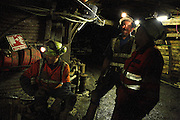 Miners are having a laugh while on a short break from work inside Unity Mine, on Tuesday, June 19, 2007, in Cwmgwrach, Vale of Neath, South Wales. The time is ripe again for an unexpected revival of the coal industry in the Vale of Neath due to the increasing prize and diminishing reserves of oil and gas, the uncertainties of renewable energy sources, and the technological advancement in producing energy from coal while limiting emissions of pollutants, has created the basis for valuable investment opportunities and a possible alternative to the latest energy crisis. Unity Mine, in particular, has started a pioneering effort to revive the coal industry in the area, reopening after more than 8 years with the intent of exploiting the large resources still buried underground. Coal could be then answer to both, access to cheaper and paradoxically greener energy and a better and safer choice than nuclear energy as a major supply for the decades to come. It is estimated that coal reserves in Wales amount to over 250 million tonnes, or the equivalent of at least 50 years of energy supply, while the worldwide total coal could last for over 200 years as a viable resource compared to only a few decades of oil and natural gas.