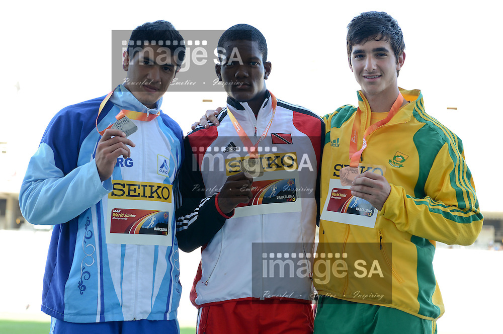 BARCELONA, Spain: Saturday 14 July 2012, Braian Toledo (Argentina, silver), Keshorn Walcott (Trinidad and Tobago, gold) and Morne Moolman (South Africa, bronze) medal winners in the mens javelin during day 5 of the IAAF World Junior Championships at the Estadi Olimpic de Montjuic..Photo by Roger Sedres/ImageSA