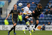 Alan Browne of Preston North End and Jed Wallace of Millwall contest an aerial ball  during the EFL Sky Bet Championship match between Preston North End and Millwall at Deepdale, Preston, England on 23 September 2017. Photo by Paul Thompson.