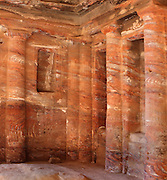 Coloured Triclinium, 200 BC - 200 AD, Petra, Ma'an, Jordan. Situated opposite the Roman Soldier's Tomb, this is the only room in a funeral complex at Petra with carved architectural decoration in its interior. The Nabatean funerary banqueting hall is decorated with engaged columns and niches and was originally covered with painted stucco. Petra was the capital and royal city of the Nabateans, Arabic desert nomads. Picture by Manuel Cohen
