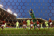 Nottingham Forest goalkeeper Dorus de Vries (1)  claims the ball with Brighton central defender, Connor Goldson (17)  watching on during the Sky Bet Championship match between Nottingham Forest and Brighton and Hove Albion at the City Ground, Nottingham, England on 11 April 2016. Photo by Simon Davies.