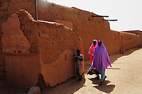 Niger,Agadez,2007. Although they may be humble, many residences are walled off from passersby, as these are near Mohammad Ixa's family home..