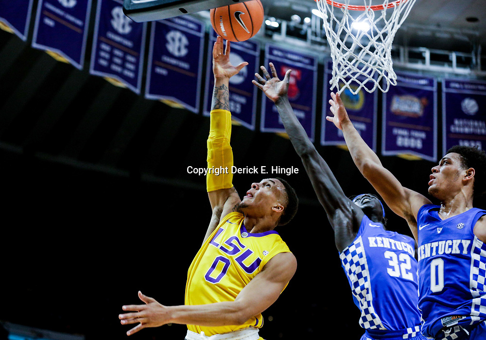 Jan 3, 2018; Baton Rouge, LA, USA; LSU Tigers guard Brandon Sampson (0) shoots over Kentucky Wildcats forward Wenyen Gabriel (32) and guard Quade Green (0) during the second half at the Pete Maravich Assembly Center. Kentucky defeated LSU 74-71.  Mandatory Credit: Derick E. Hingle-USA TODAY Sports