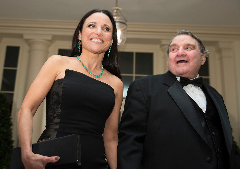 Julia Louis-Dreyfus and her father Gérard Louis-Dreyfus arrive for the State Dinner being held for French President Francois Hollande at the White House in Washington on February 11, 2014.      REUTERS/Joshua Roberts    (UNITED STATES)
